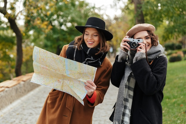 Portrait of two attractive girls dressed in autumn clothes
