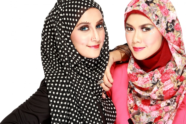 Portrait of two beautiful muslim women having fun