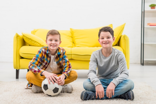 Portrait of two boys at home