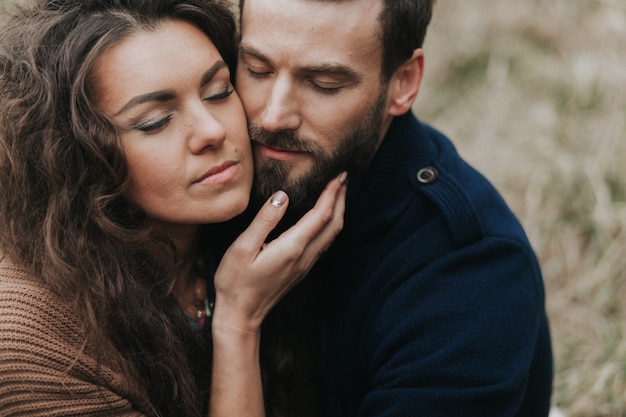 Portrait of two caucasian lovers. young couple is hugging on autumn day outdoors. valentine's day. concept of love and family.