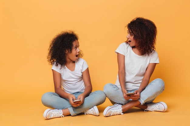 Portrait of a two cheery afro american sisters