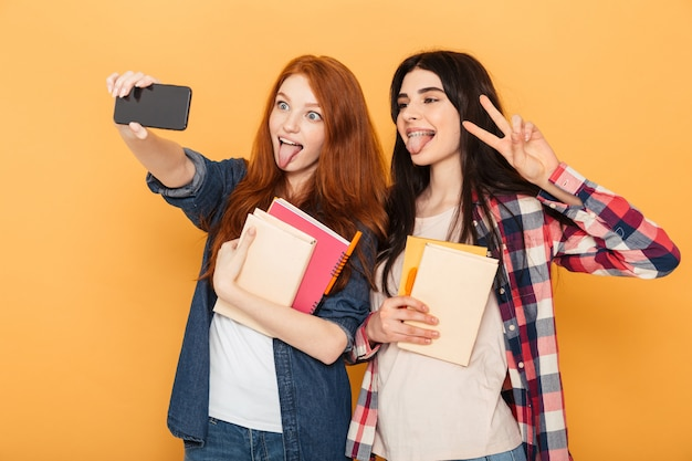 Portrait of two funny young school women
