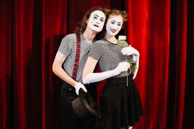 Portrait of two mime artist in love