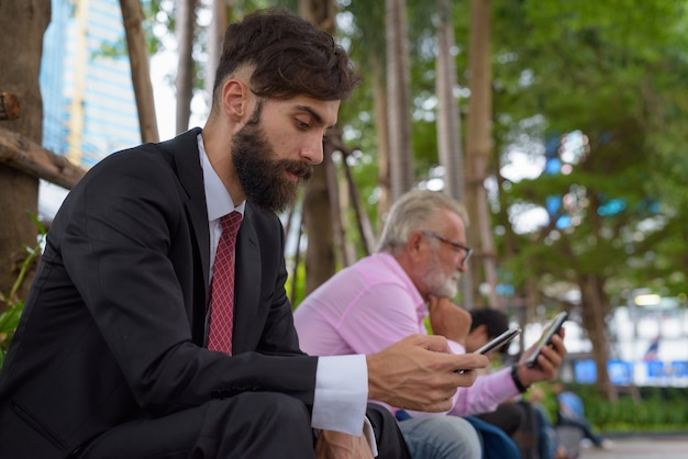 Portrait of two multi ethnic bearded businessmen together around the city of bangkok Premium Photo