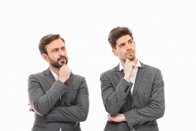 Portrait of a two pensive business men