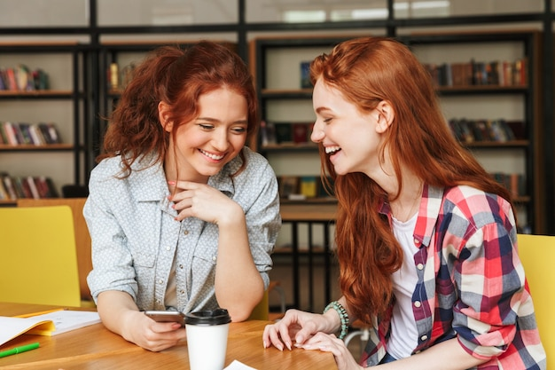 Portrait of a two smiling teenage girls