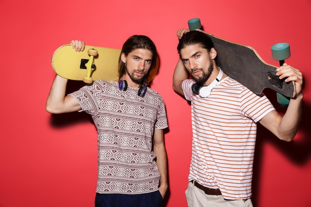 Portrait of a two young attractive twin brothers isolated