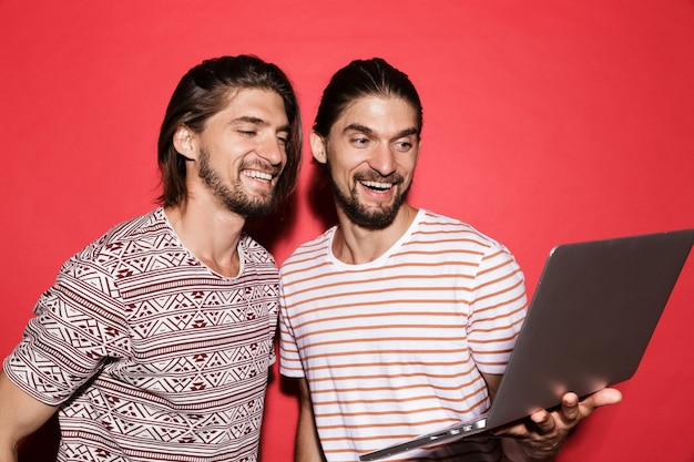 Portrait of a two young happy twin brothers