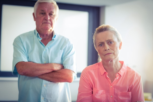 Portrait of unhappy senior couple