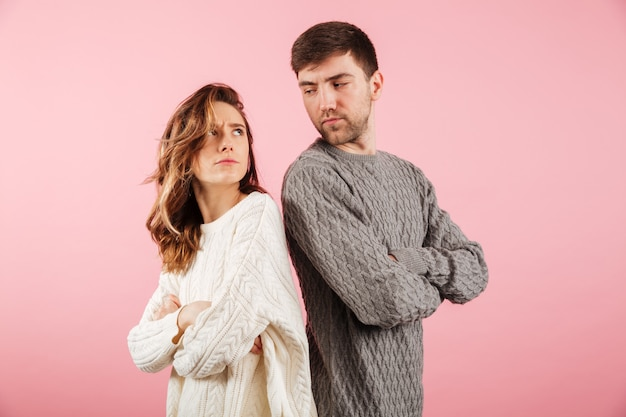 Portrait of an upset couple dressed in sweaters