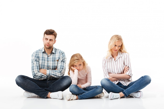 Portrait of an upset family sitting together