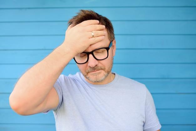 Portrait of upset man in eyeglasses