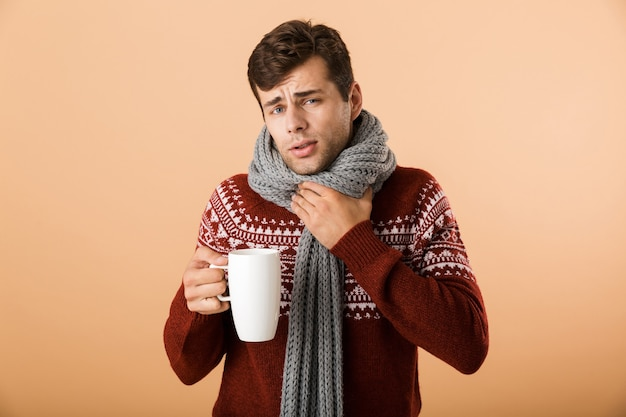 Portrait of an upset young man dressed in sweater