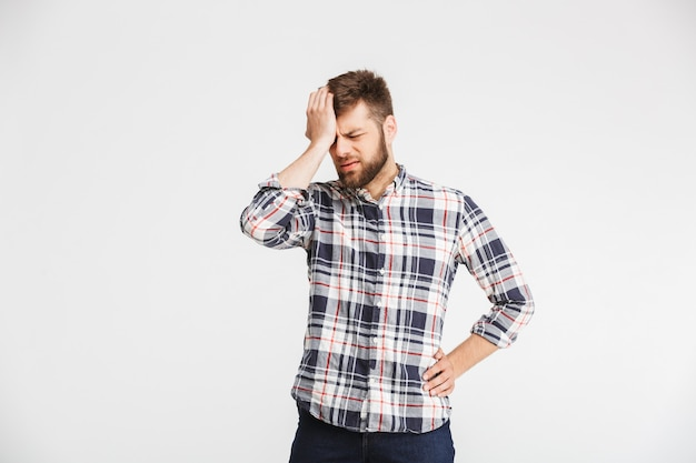 Portrait of a upset young man in plaid shirt
