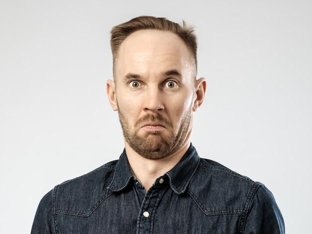 Portrait of upset young man