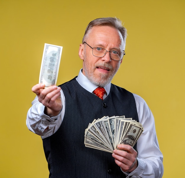 Portrait of very excited man with bunch of money.