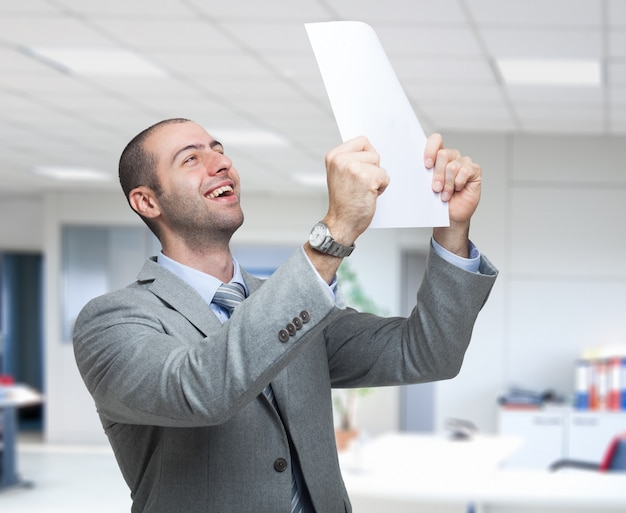 Portrait of a very happy business man holding a document