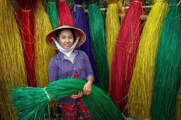 Portrait of vietnamese female craftsman drying traditional vietnam mats