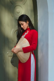 Portrait of vietnamese girl traditional red dress,beautiful young asian woman wearing vietnam