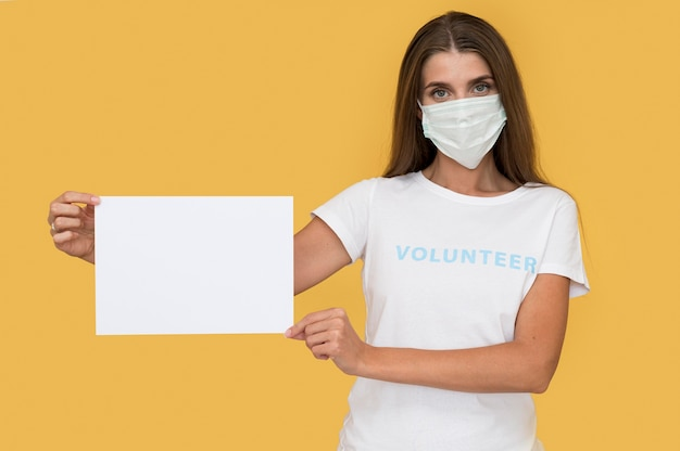 Portrait of volunteer wearing face mask