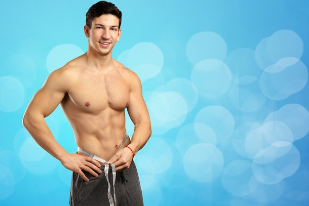 Portrait of a well built shirtless muscular male model