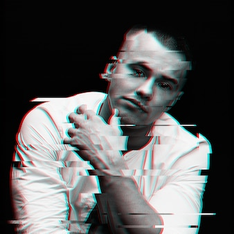 Portrait of a white man with a virtual reality glitch effect on a black space