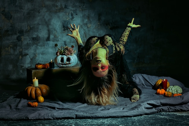 Portrait of witch with halloween makeup
