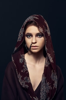 Portrait of a woman in bathrobe with hood
