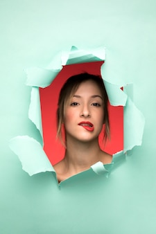 Portrait of woman biting her lip