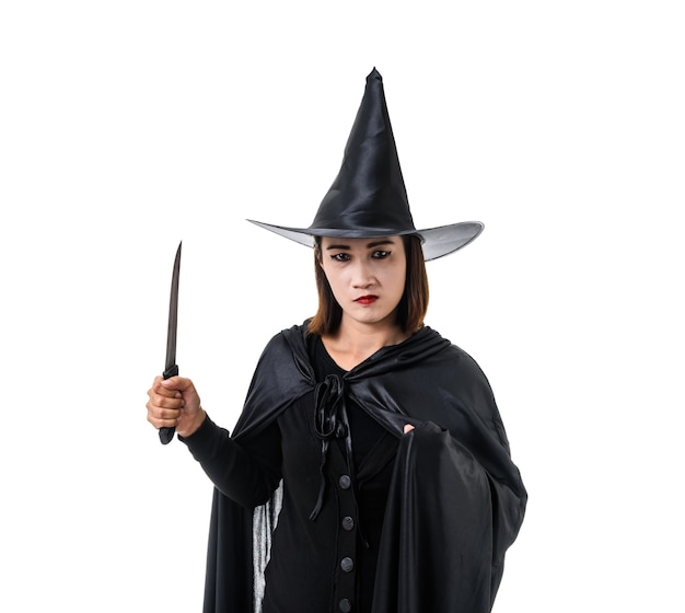 Portrait of woman in black scary witch halloween costume standing with hat standing isolat