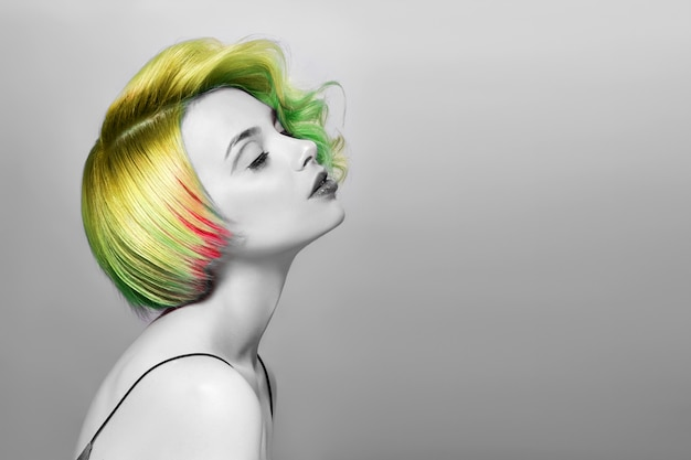 Portrait of woman bright colored flying hair green