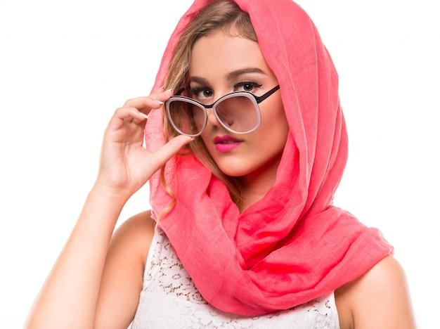Portrait woman in bright crimson headscarf and sunglasses.