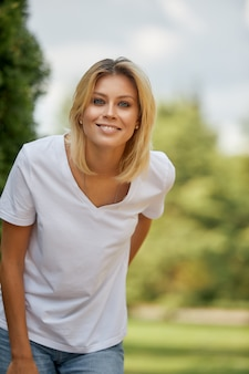 Portrait of a woman, closeup portrait of a nice female looking at camera.concept woman lifestyle,happy healthy summer vacation.