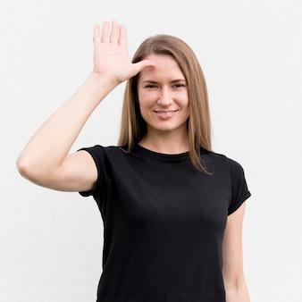 Portrait of woman communicating through sign language
