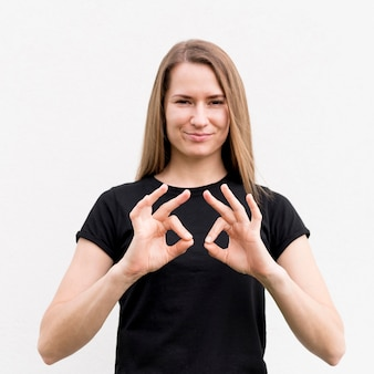 Portrait of woman communicating through sign language