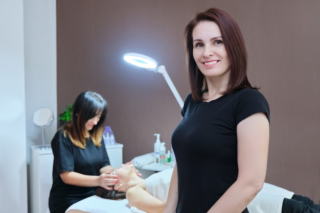 Portrait of woman cosmetologist at beauty clinic