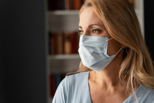 Portrait of woman counselor with face mask in office