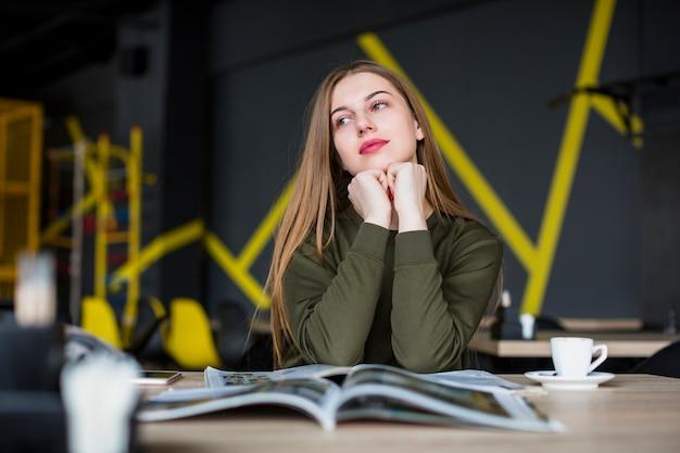Portrait of woman at desk