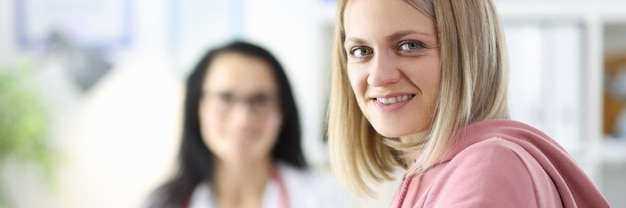 Portrait of woman and doctor in medical office ambulance