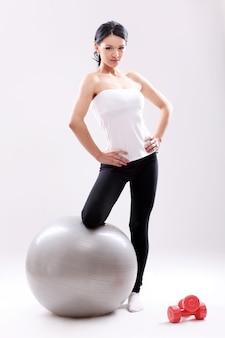 Portrait of a woman doing pilates