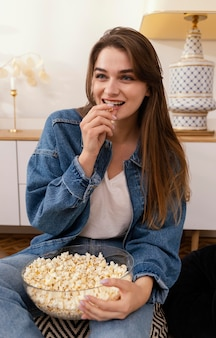 Portrait woman eating popcorn