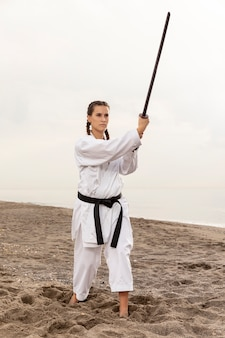 Portrait of woman exercising karate