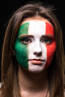 Portrait of woman face supporter fan of mexico national team with painted flag face isolated on black background. fans emotions.