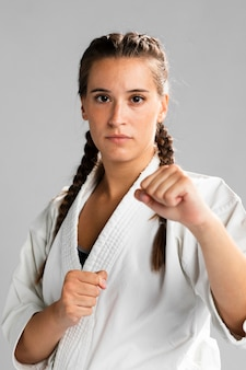 Portrait of a woman fighter ready to get into a combat