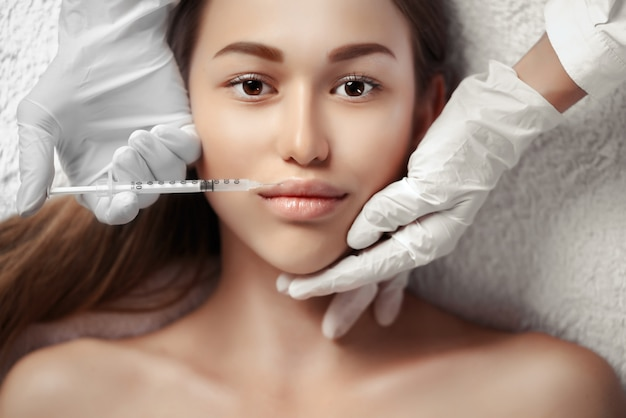 Portrait of woman getting cosmetic injection
