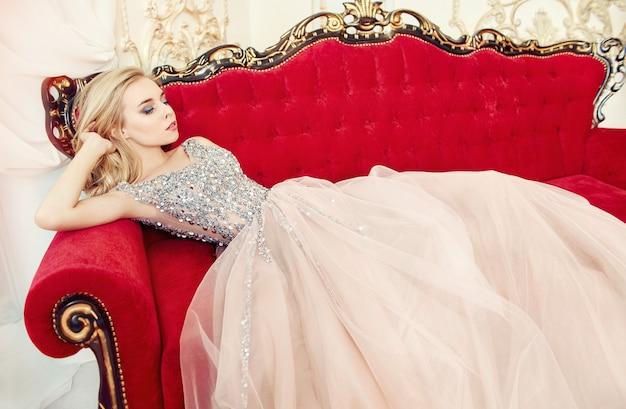 Portrait of a woman in a glittering festive dress