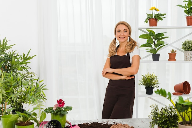 Portrait woman in greenhouse