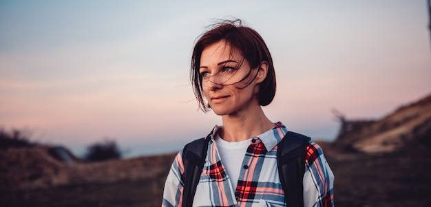 Portrait of woman hiking on mountain