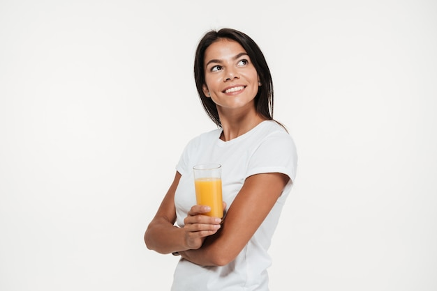 Portrait of a woman holding glass of an orange juice