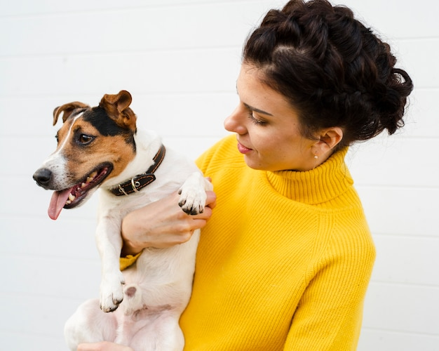 Portrait of woman holding her dog